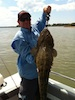 Moreton Bay Charters Skipper with large Flathead